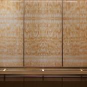LEVELe-105 Elevator Interior with upper panels in ViviStone Honey Onyx