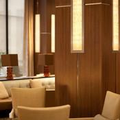 Column accents in backlit ViviStone Honey Onyx