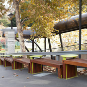Custom Hudson Benches with powdercoated tables and FSC 100% Ipé hardwood slats