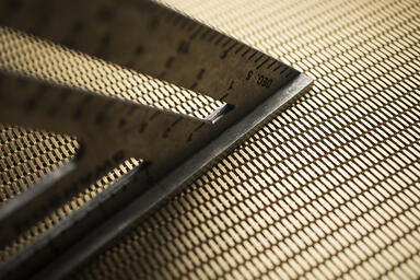 Linq Woven Metal shown with Merge CrossLinq pattern in Brass