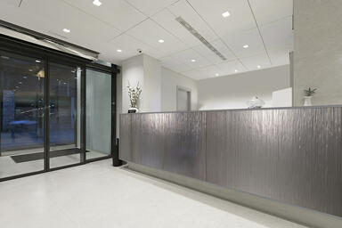 Reception desk shown in BermanGlass Levels Kiln Cast glass