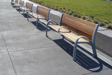 Camber Benches shown in 6 foot configuration with Aluminum Texture powdercoated