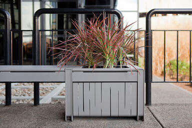 Vector Seating System planter with stainless steel side panels