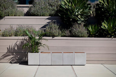"Quadra 17"" modules shown with FSC Recycled reclaimed Teak insets and planter"