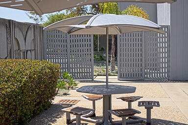 Soleris Sunshade shown with aluminum panels with Slat perforation pattern