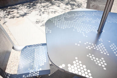 Detail of Tangent Table Ensemble with shadow from Soleris Cloud perforation