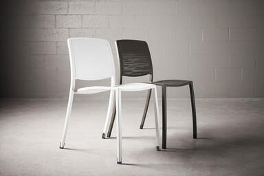 Avivo Chairs shown with White Texture powdercoat and Vento perforation pattern