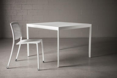 Avivo Chair shown with White Texture powdercoat with Vento perforation pattern