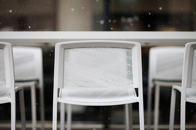 Avivo Bar Stools shown with Stella perforation and Cream Texture powdercoat