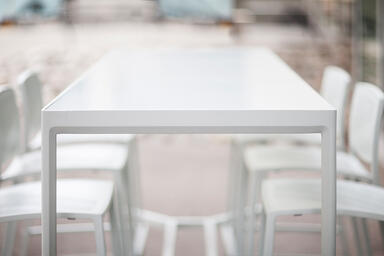 Avivo Bar Table shown with Cream Texture powdercoated frame