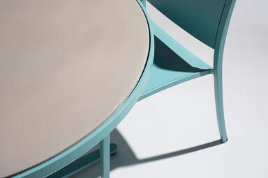 Detail of Avivo Pedestal Café Table, shown with custom color powdercoat