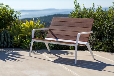 Vaya bench shown with White Texture powdercoated frame and FSC® 100% Cumaru