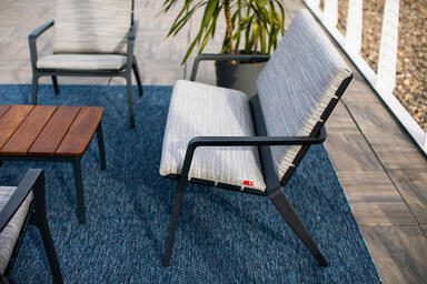 Vaya Textile Bench, Chair, and Vaya Side Table shown with Ink Blue Texture