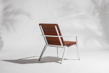 Vaya chair shown with White Texture powdercoated frame and FSC® 100% Cumaru