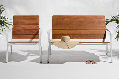 Vaya bench and chair shown with White Texture powdercoated frames and FSC® 100%