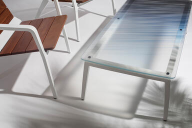 Vaya chairs shown with White Texture powdercoated frames and FSC® 100% Cumaru