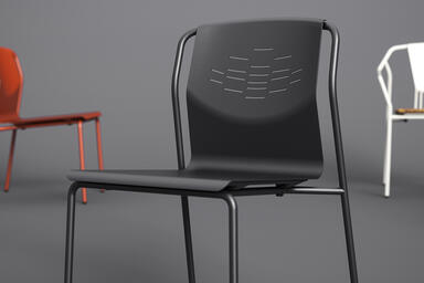 Factor Chair without arms shown formed aluminum seat in Black Texture powdercoat