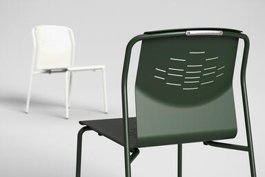 Factor Chair without arms shown with formed aluminum seat in Moss Texture