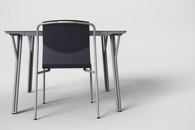 Factor Chair without arms shown with formed aluminum seat in Ink Blue Texture