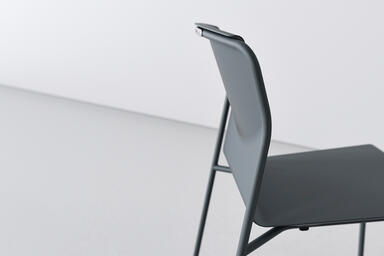 Factor Chair shown in formed aluminum seat and back configuration with Cool Grey