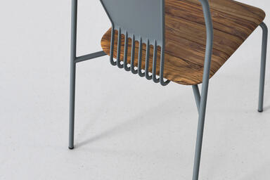 Factor Chair shown in cast aluminum back and FSC 100% Teak configuration