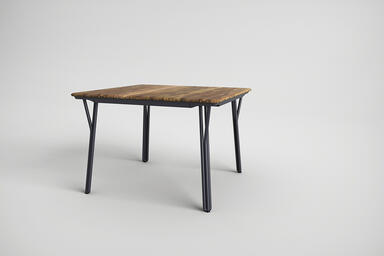Factor Table shown with Ink Blue Texture powdercoated frame and FSC 100% Teak