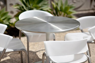 Citrus Table, Satin Stainless Steel, perforated top, Bantam Chairs