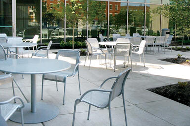 Column Tables shown with Bright Silver Gloss powdercoat; Vista Chairs also shown