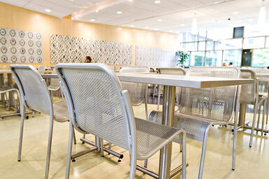 Vista Chairs shown with Bright Silver Gloss powdercoat; Cross Tables also shown