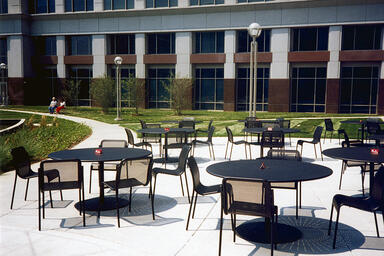 Vista Chairs shown with Black Texture powdercoat; Column Tables also shown