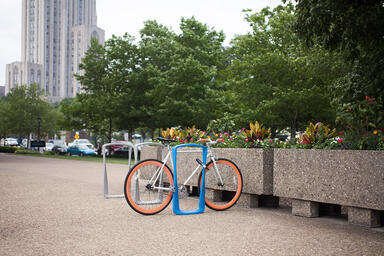 Twist Bike Racks shown with Azure and Aluminum Texture powdercoat