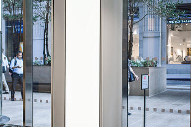 LEVELe Column System, LightPlane Panels with ViviChrome Chromis glass with White