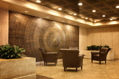 Bonded Metal wall in Bonded Bronze with Dark Patina and Solstice pattern