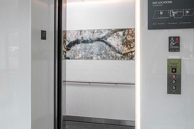 LEVELe-104 Elevator Interior with Minimal panels in ViviSpectra Spectrum glass w