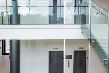 Columns in Elemental Carbon with Ice finish; Elevator doors in Elemental Carbon