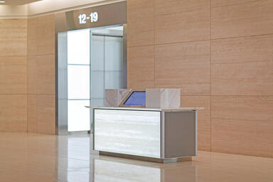 Reception desk with LightPlane Panel in ViviGraphix Graphica glass with custom g