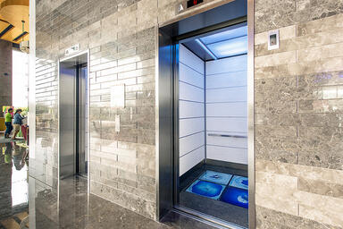 LEVELe-103 Elevator Interior with Capture panels in Bonded Quartz, White