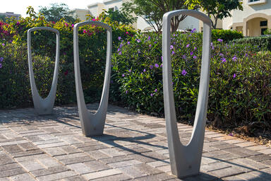 Trio Bike Racks shown with Aluminum Texture powdercoat at Al Ghadeer Residential