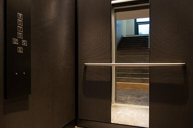 LEVELe-105 Elevator Interior with customized panel layout; panels in Bonded Nick
