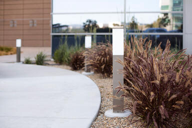 Rincon Bollards shown in Stainless Steel with Satin finish and base with custom