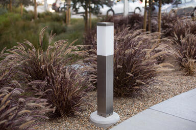 Rincon Bollard shown in Stainless Steel with Satin finish and base with custom