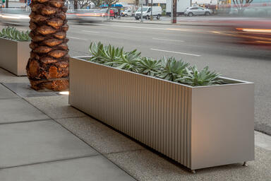 Custom planters in Stainless Steel with Seastone finish and Stainless Steel with