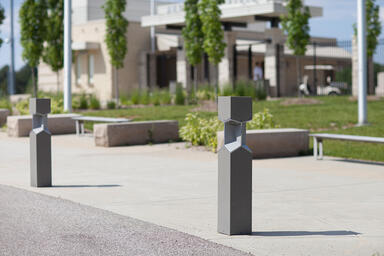 Knight Bollards shown with Slate Texture powdercoat; also shown, Apex Benches