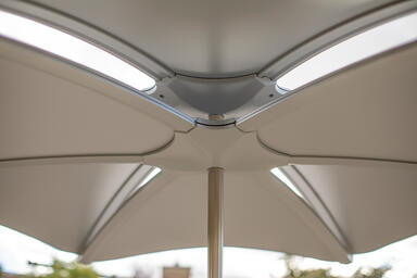 Detail of Soleris Sunshade shown with panels and frame in Aluminum Texture powde