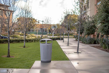 Dispatch Litter & Recycling Receptacle shown in split-stream configuration with