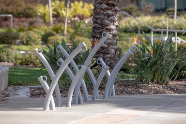 Bike Garden Bike Racks shown in cast-in-place configuration with Aluminum Textur
