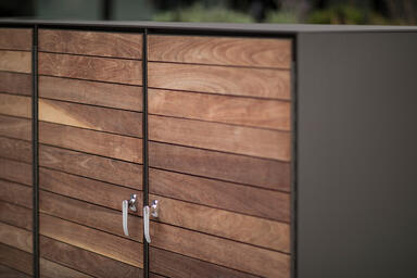 Custom cabinet in Slate Texture powdercoat, with FSC® 100% Jatoba hardwood slats