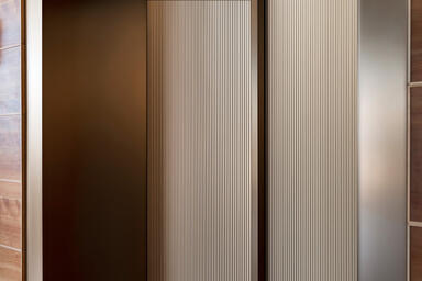 Elevator doors shown in Fused Bronze