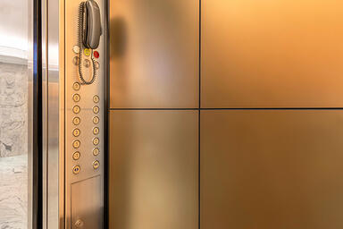 LEVELe-105 Elevator Interior with customized panel layout; panels in Fused Bronz