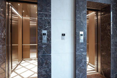 LEVELe-105 Elevator Interiors with customized panel layout; Minimal panels in Bo